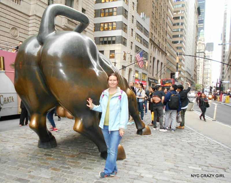 charging-bull-wall-street-new-york-crazy-girl