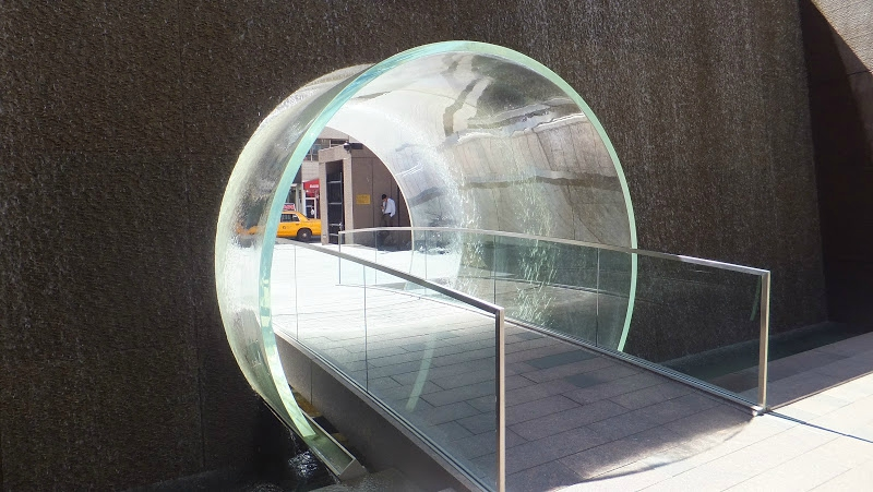 glass waterfall tunnel new york street art